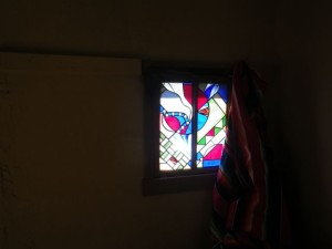 Stained glass window in the bedroom.