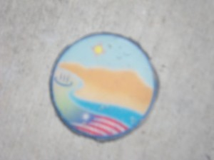 These little medallions appear several times in the sidewalks.