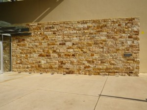 Stone wall outside the museum.