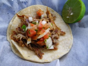 Carnitas (shredded pork) taco.