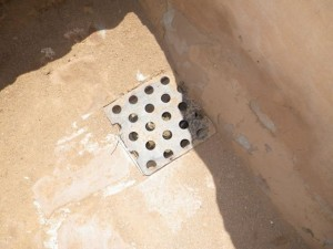 This drain is original! The holes in it are perfectly round!